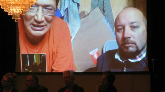 Zacharias Kunuk and Matthew Biederman on live video satellite link from the Arctic wilderness to Canada House, London, 20 May 2010